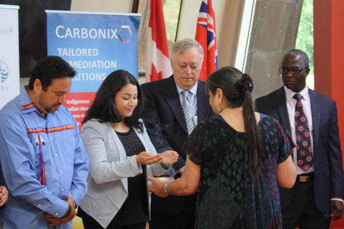 Peterborough-Kawartha MP Maryam Monsef during the indigenous smudging ceremony at the July 15, 2019 announcement at Trent University of $3.1 million in federal funding for Canadian indigenous technology company Carbonix Inc., which is partnering with Trent University and SGS Lakefield to scale up a project that produces tailored activated carbons from sustainably sourced feedstocks and uses them to capture contaminants from industrial waste streams and mine tailings. (Photo: Office of Maryam Monsef