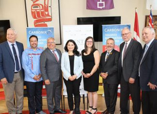 Carbonix president and CEO Paul Pede (third from left) and Peterborough-Kawartha MP Maryam Monsef (fourth from left) at an announcement of $3.1 million in federal funding on July 15, 2019 at Trent University for a clean technology pilot project led by Carbonix Inc., a Canadian indigenous technology company, that aims to use resources more efficiently to reduce pollution and water waste. (Photo: Office of Maryam Monsef)