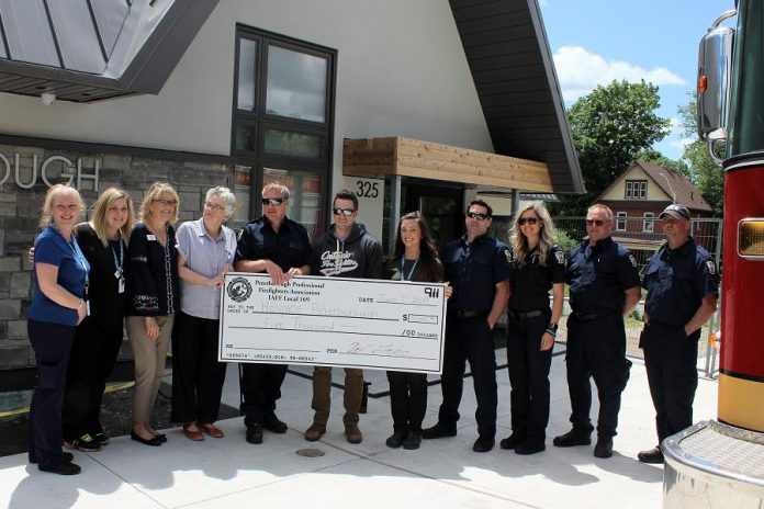 The Peterborough Professional Fire Fighters Association presents a cheque for $5,000 to Hospice Peterborough in June. (Photo courtesy of Hospice Peterborough)