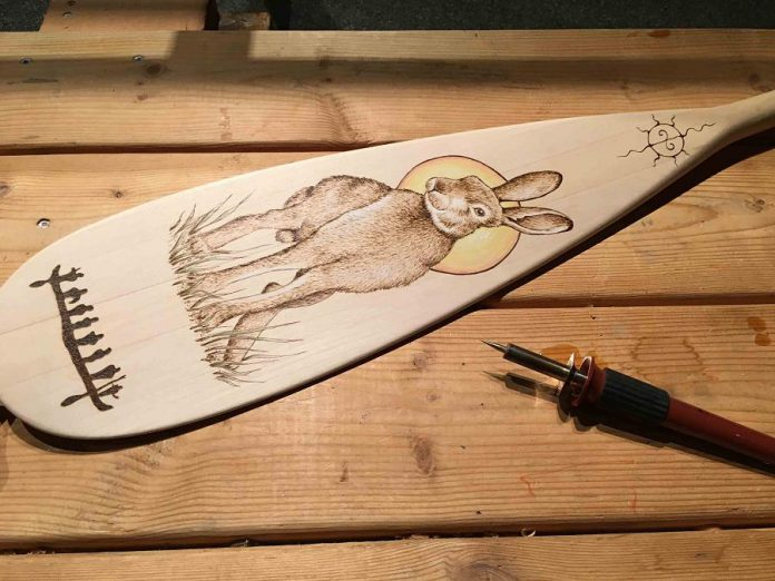 Make a one-of-a-kind woodburned paddle at an artisan workshop  on Saturday, August 17th at The Canadian Canoe Museum. (Photo courtesy of The Canadian Canoe Museum)