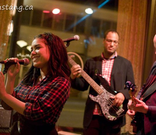 """Charlene """"Charlie"""" Earle performing with her quartet Little Fire in April 2014 at the former Barbeside Salon, with Aaron Cavon on bass and Dave Tough on guitar (not shown: Brandon Root on drums). Earle passed away on July 19, 2019 at the age of 33. (Photo: Esther Vincent / evmustang.ca)"""