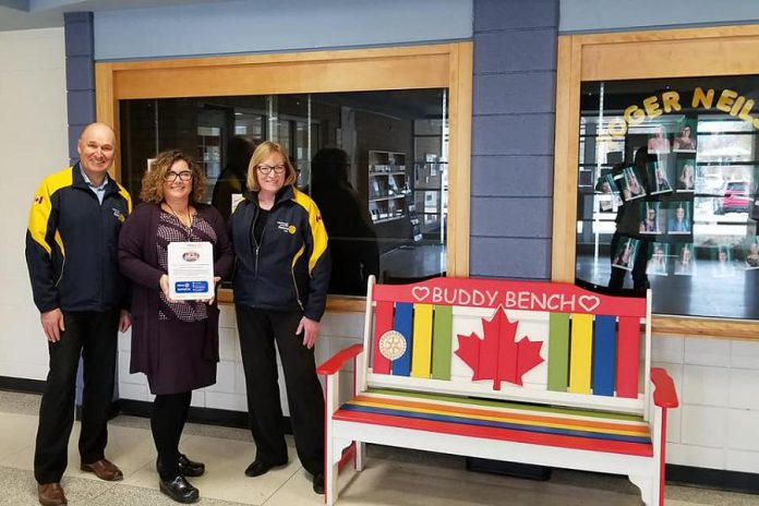 Donna Geary (right) with  Rotary Club of Peterborough Kawartha president Brian Prentice and principal Denise Humphries after the donation of a buddy bench to the school. Donna and her son Nate began the initiative in 2017. (Photo: Rotary Club of Peterborough Kawartha)