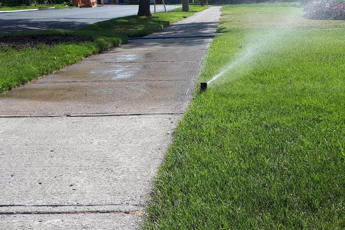 This summer, skip the sprinkler and rely on the rain. While sprinklers mostly water lawns, they also water unwanted places like sidewalks, driveways, and pedestrians. It is increasingly important to use less water outside and to recognize wasteful usage, especially in the summer when our water supply is most stressed. (Photo: Heather Ray)