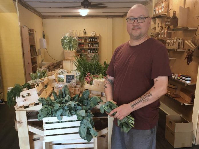 Anthony Lennan offers a variety of fresh produce and local groceries at The Food Shop in downtown Peterborough. (Photo: Eva Fisher / kawarthaNOW.com)
