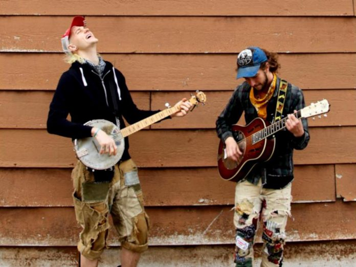 Taylor Esch and Kieran Northbound, two members of Kitchener acoustic band The Oldest Man I Know, bring their high-energy punk-inspired folk music to The Garnet in downtown Peterborough on Tuesday, July 9th. (Photo: The Oldest Man I Know)
