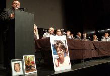 As panel members look on and with photographs of overdose victims displayed on stage, Ontario Associate Minister of Health and Addictions Michael Tibollo speaks at the Opioid Summit on July 11, 2019 at Market Hall Performing Arts Centre in downtown Peterborough. The summit was jointly organized and hosted by Peterborough Mayor Diane Therrien and Selwyn Deputy-Mayor Sherry Senis. (Photo: Office of Michael Tibollo / Twitter)