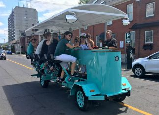 PedalBoro's 15-passenger party bike received a fair share of attention on Tuesday (July 16) during the bike tour company's inaugural downtown tour from The Olde Stone Brewing Company to the Publican House Brewery before heading to Millennium Park. (Photo: Paul Rellinger / kawarthaNOW.com)