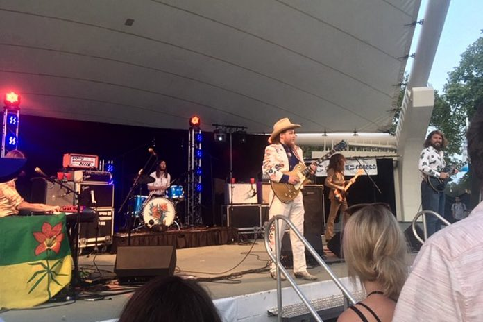 Baileboro native Jimmy Bowskill takes centre stage at The Sheepdogs concert at Peterborough Musicfest in Del Crary Park on July 24, 2019. Eleven people attending the free concert were charged under the City of Peterborough's no-smoking for smoking, vaping, and using cannabis. (Photo: Eva Fisher / kawarthaNOW.com)