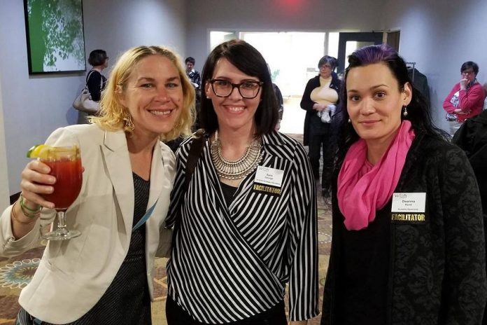 During every member meeting of the Women's Business Network of Peterborough (WBN), each dinner table includes an established WBN member who acts as a facilitator to encourage converation among members, making first timers feel especially welcome. Pictured is    Carlotta James, who joined WBN in 2018-19, socializing before dinner with facilitators Sara George and Deanna Hunt at the May 2019 member meeting. (Photo: WBN)