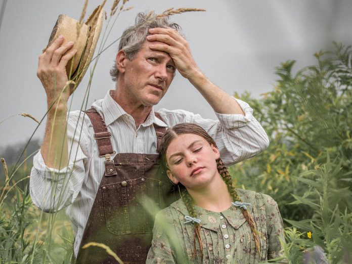 "Kevin Bundy and Asha Hall-Smith in the world premiere of Robert Winslow and Ian McLachlan's ""Carmel"" at 4th Line Theatre. The play, which focuses on the White family's attempt to save the family farm during the Great Depression of the 1930s, runs Tuesdays to Saturdays until August 31, 2019 at the Winslow Farm in Millbrook. (Photo: Wayne Eardley / Brookside Studio)"