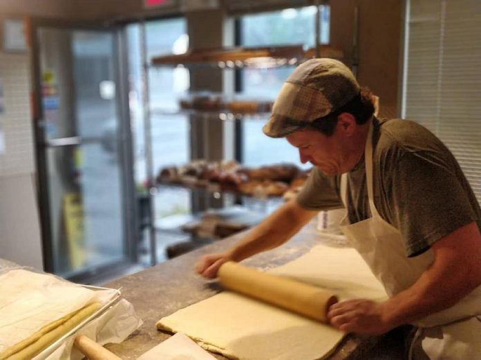 Mickaël Durand at work at Mickaël's Café Librairie in Lindsay. The boulangerie owner has opened a second location in Omemee. (Photo: Mickaël's Café Librairie)