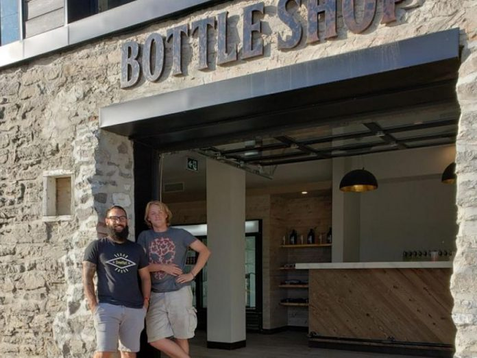 Fenelon Falls Brewing Co. general manager Mathew Renda and head brewer Russell Gibson at the brewery's new Bottle Shop, which officially opened on August 24, 2019 and sold out within hours. (Photo courtesy of Fenelon Falls Brewing Co.)