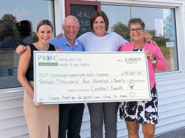 Central Smith Creamery owner Ian Scates (second from left) and vice-president/marketing Jenn Scates (right) present a cheque for $13,420.25 to Jane Lovett (left) and Lesley Heighway (second from right) of PRHC Foundation on August 1, 2019 at the dairy's location at 739 Lindsay Road in Peterborough. (Photo courtesy of PRHC Foundation)