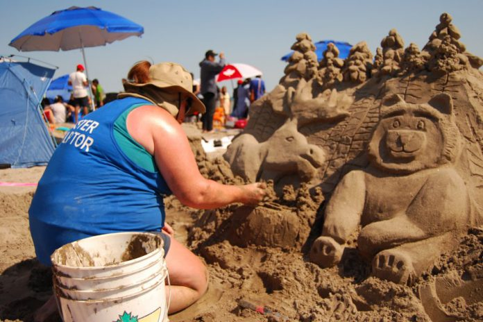 Master sculptor Tanya Kastl of Waterloo works on her design during the Cobourg Sandcastle Festival on August 3, 2019 at Victoria Beach in the Town of Cobourg. (Photo: April Potter / kawarthaNOW.com)