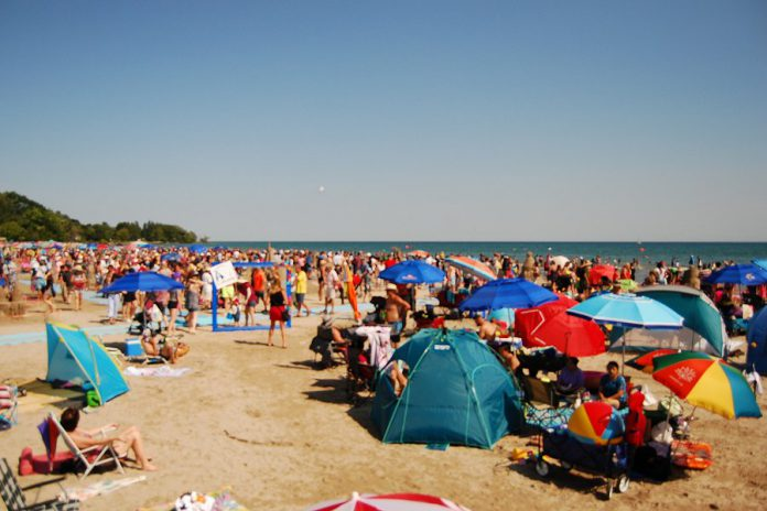 Crowds of people filled Cobourg's Victoria Beach on the shores of Lake Ontario for the town's 14th annual sandcastle festival  on August 3, 2019. (Photo: April Potter / kawarthaNOW.com)
