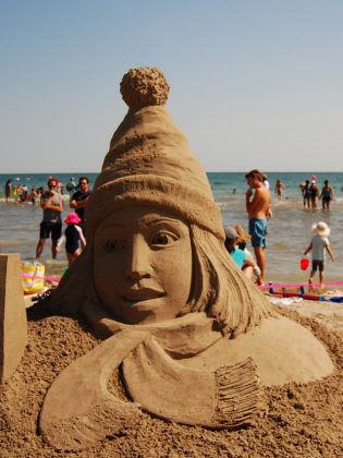 """A detail of the work by master sculptor Karen Fralich the Cobourg Sandcastle Festival on August 3, 2019 at Victoria Beach in the Town of Cobourg. """"Why We Love Canada"""" was the theme for the master sculptors, who came from across Canada and the U.S. (Photo: April Potter / kawarthaNOW.com)"""
