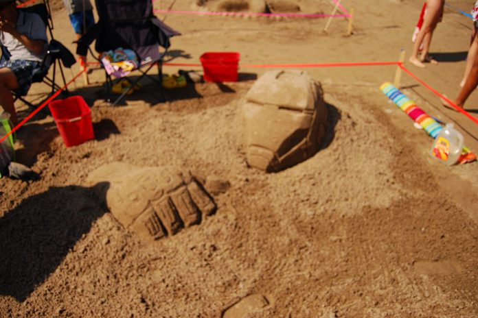 """""""Iron Man"""" by Yan was another sculpture in the amateur competition at the Cobourg Sandcastle Festival on August 3, 2019 at Victoria Beach in the Town of Cobourg. (Photo: April Potter / kawarthaNOW.com)"""