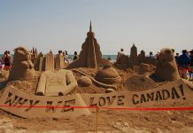 """""""Why We Love Canada"""" was the theme for master sculptors from Canada and the U.S. at the 14th annual Cobourg Sandcastle Festival, held on August 3, 2019 at Victoria Beach in the Town of Cobourg. The day also featured an amateur competition where public teams vyed for top prizes in five categories. (Photo: April Potter / kawarthaNOW.com)"""