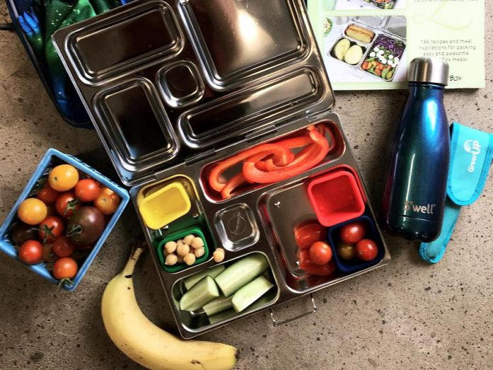 Stainless steel containers keep fresh food tasting its best, so there's no need to purchase unhealthy prepackaged snacks. And you can replace the disposable juice box with a reusable drink container filled with home-brewed fruit tea. (Photo: GreenUP)