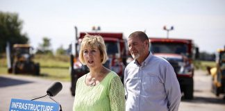 Ontario Minister of Infrastructure Laurie Scott announced $790,000 to help the municipality of Kawartha Lakes improve public transit on August 16, 2019 at Lindsay Transit's bus maintenance facility in Lindsay. Pictured in the background is Kawartha Lakes Mayor Andy Letham. (Photo: Office of Laurie Scott)