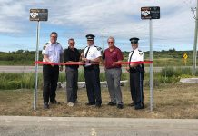 Two Project Safe Trade parking spots were launched at the Kawartha Lakes OPP Detachment in Lindsay on August 15, 2019. Pictured are Municipal Law Enforcement Manager Aaron Sloan, Mayor Andy Letham, Inspector Tim Tatchell, Councillor Ron Ashmore, and Staff Sergeant Robert Flindal. (Photo courtesy of the municipality of Kawartha Lakes)