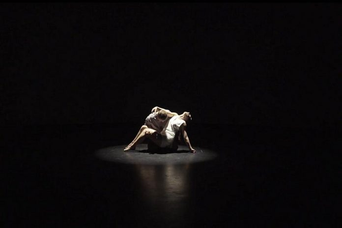 "Through spoken word and original music and choreography, ""Surfacing"" explores the impact of mental illness and suicide on writer Frank Flynn's family. Originally intended to be a live dance performance, it was instead turned into a film that is now available for online viewing. Pictured are dancers Oliver Moriarty and Sierra Richardson.  (Screenshot)"