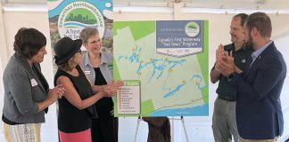 "A map of the Trent-Severn Trail Town program, Canada's first waterway ""trail town"" program, was unveiled at a launch event on August 22, 2019 at Ranney Falls (Locks 11-12) in Campbellford. Pictured from left to right: Cycle Forward founder and trail town consultant Amy Camp, Northumberland-Peterborough South MP Kim Rudd, Kawarthas Northumberland/Regional Tourism Organization 8 (RTO8) Executive Director Brenda Wood, Parks Canada Associate Director for Ontario Waterways Dwight Blythe, and Northumberland-Peterborough South MPP David Piccini. (Photo courtesy of RTO8)"