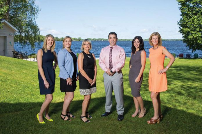 The team of The Pyle Group of ScotiaMcLeod: Administrative Associate Tammy Sargeant, Senior Associate Brittany Beach, Investment Associate Eileen Huggins, Portfolio Manager and Senior Wealth Advisor Andrew Pyle, Wealth Advisor Ally Pyle, and Investment Associate Emily Downie. (Photo courtesy of Dockside Magazine)