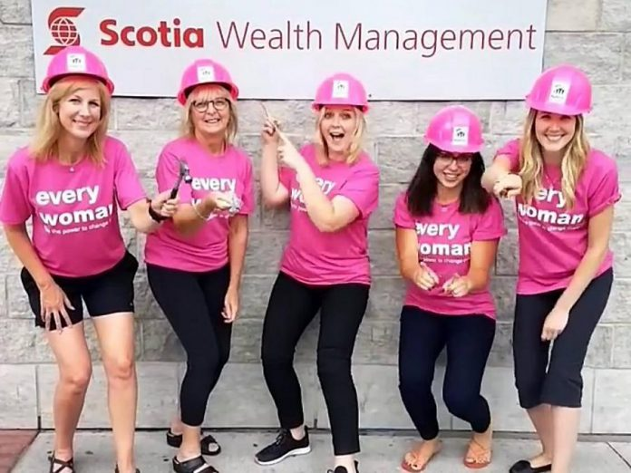 Team members of The Pyle Group of ScotiaMcLeod volunteering for Habitat For Humanity Peterborough & Kawartha Region's Women Build project: Investment Associate Emily Downie, Investment Associate Eileen Huggins, Senior Associate Brittany Beach,  Wealth Advisor Ally Pyle, and Administrative Associate Tammy Sargeant. (Supplied photo)
