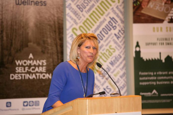 Betty Halman-Plumley, shown here speaking at the International Women's Day Conference Peterborough, is a past president of the Women's Business Network of Peterborough. (Photo; International Women's Day Conference Peterborough)