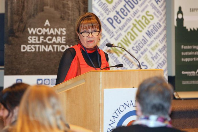The Ear Depot owner and operator Brenda Cowan, shown here speaking at the Peterborough International Women's Day Conference, understands that developing insightful and understanding relationships with her clients is the most important step in helping them with their hearing needs. (Photo: IWD Peterborough)