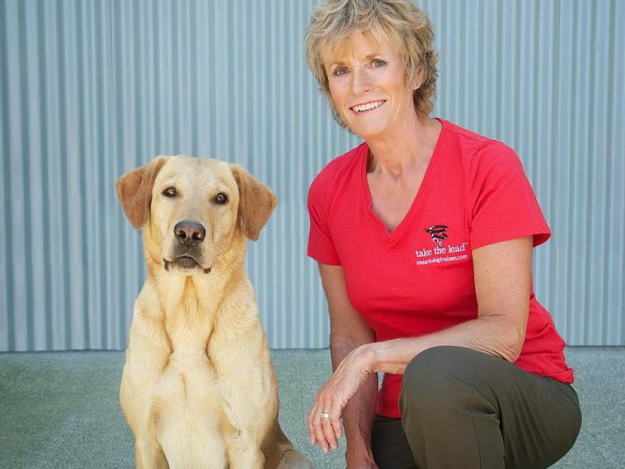 "Ontario Dog Trainer Karen Laws with her dog Persi. For 14 years, Karen has taught dog owners how to build a relationship with their pets based on trust and leadership. Now she is expanding her boarding programs such as ""dog university"", where dogs come to stay for several weeks at Karen's Bethany facility. Karen teaches the dogs desired behaviour and also teaches the owners how to have the life they dream of with their dog. (Supplied photo)"