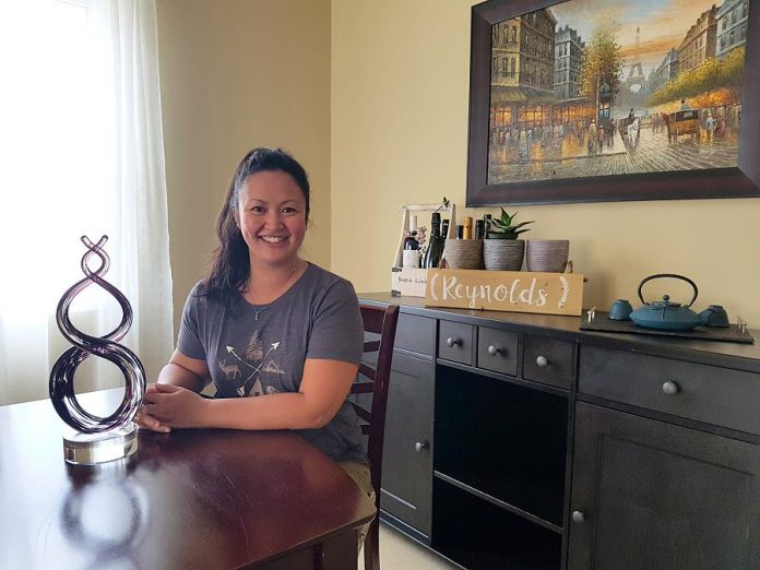 Grace Reynolds at home with her Best Newcomer Agent award that she received from the Mortgage Awards of Excellence in May 2018. (Photo: Amy Bowen / kawarthaNOW.com)