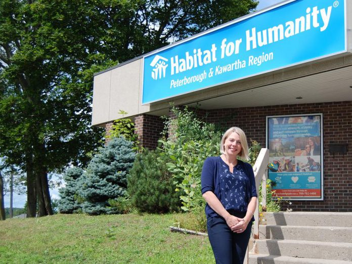 Habitat for Humanity Peterborough & Kawartha Region CEO Sarah Burke outside the organization's offices at 300 Milroy Drive in Peterborough. Habitat for Humanity Peterborough & Kawartha Region is launching its first-ever multi-residential project to construct a 41-unit affordable condo building in Peterborough, expanding the organization's efforts to provide affordable home ownership to low-income couples, singles, single-parent families, and seniors. (Photo: April Potter / kawarthaNOW.com)