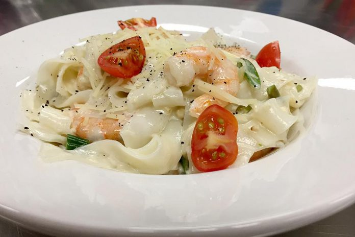 This dish of pan-seared shrimp alfredo over glass noodles with marinated grape tomatoes is an example of the fresh and healthy meals that Tracey Ormond prepares for Classic Cooking, a meal delivery service for seniors and families in Peterborough that Tracey operates with Sally Harding of Nightingale Nursing. (Supplied photo)