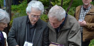"Renowned Canadian wildlife artists Michael Dumas and Robert Bateman in Algonquin Park at the 75th anniversary fundraiser for the Algonquin Wildlife Research Station on September 14, 2019, where Bateman was presented with the 2019 Algonquin Park Legacy Award by Dumas, the inaugural recpient of the award from the Algonquin Art Centre. Dumas also presented Bateman with a limited edition of ""The Artists of Kawartha"", the fourth art book in a series designed and published by Algonquin-area publisher Andrea Hillo. (Photo courtesy of Andrea Hillo)"