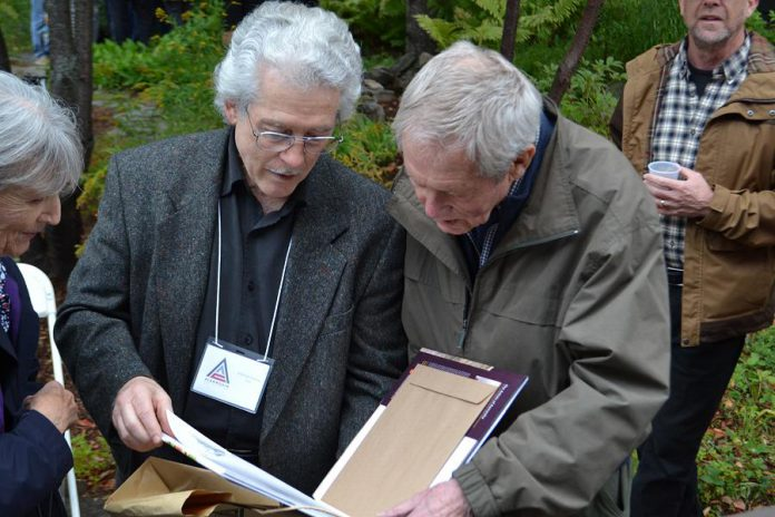 "Renowned Canadian wildlife artists Michael Dumas and Robert Bateman in Algonquin Park at the 75th anniversary fundraiser for the Algonquin Wildlife Research Station on September 14, 2019, where Bateman was presented with the 2019 Algonquin Park Legacy Award by Dumas, the inaugural recipient of the award from the Algonquin Art Centre. Dumas also presented Bateman with a limited edition of ""The Artists of Kawartha"", the fourth art book in a series designed and published by Algonquin-area publisher Andrea Hillo. (Photo courtesy of Andrea Hillo)"
