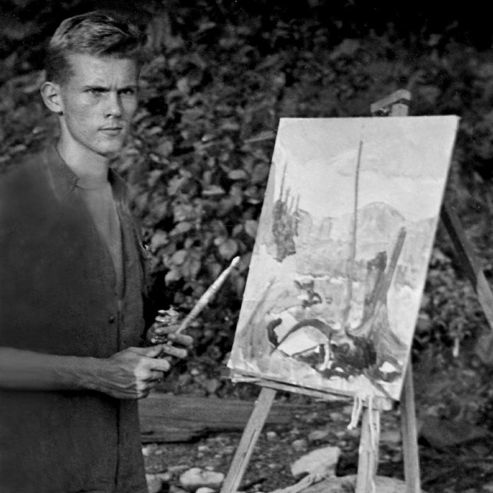 A 19-year-old Robert Bateman painting at the Algonquin Wildlife Research Station. (Photo: Algonquin Park Museum Collection)