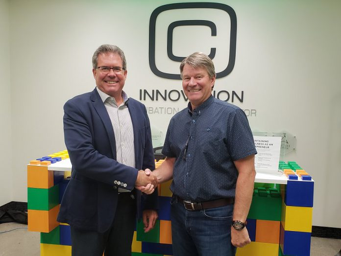 Pat Devlin of Peterborough Utilities Group and John Gillis of Innovation Cluster Peterborough and the Kawarthas. (Photo courtesy of Innovation Cluster)