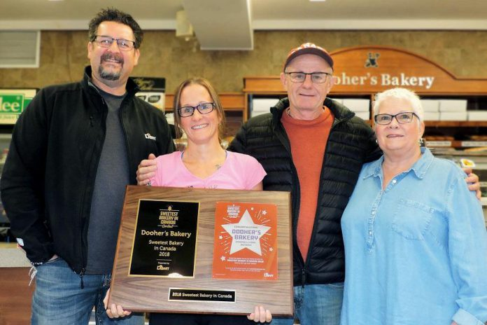 """Dooher's Bakery won the grand prize in the inaugural """"Sweetest Bakery in Canada"""" content in 2018, and is defending its title again this year. Pictured is a representative from contest sponsor Dawn Food Products (left) presenting the award plaque to owner Cory Dooher (second from left) and her parents Peter and Christine.  (Photo: Dooher's Bakery / Facebook)"""