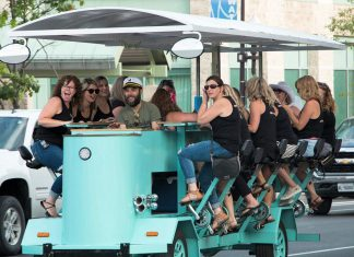 The new Pedalboro party bike tours that allow participants to visit downtown Peterborough establishments via a 15-passenger bike is one example of cycle tourism. Downtown Peterborough, one of only five bike-friendly business areas in Ontario according to Ontario By Bike,is a natural location for bike-themed experiences. (Photo courtesy of Pedalboro)