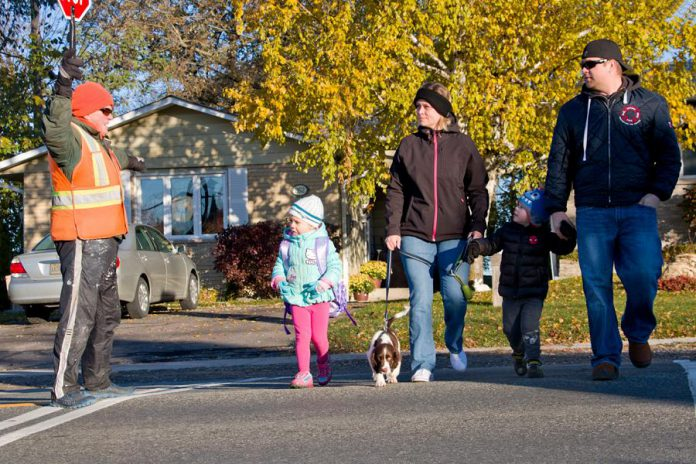 Active and Safe Routes to School Peterborough is challenging families to walk, bike, or bus to and from school this year. Planning ahead to make time for disruptions as you walk with your kids can make time for meaningful family moments and new relationships with neighbours and crossing guards. (Photo courtesy of GreenUP)