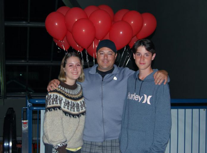 "Locals Halle and her brother Lucas, shown here with their dad Zak at the special screening of ""IT Chapter Two"" at Rainbow Cinemas in Cobourg, both appeared as extras in the film. (Photo: April Potter / kawarthaNOW.com)"