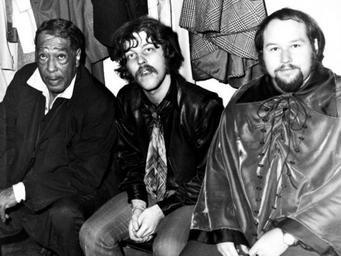"Lighthouse founding members Skip Prokop (centre) and Paul Hoffert (right) with jazz legend Duke Ellington in the Green Room before the first Lighthouse concert at The Rockpile in Toronto on May 14, 1969. The Duke introduced the band, starting with ""I'm beginning to see the Light ... house"". (Photo courtesy of Hoffert Communications)"