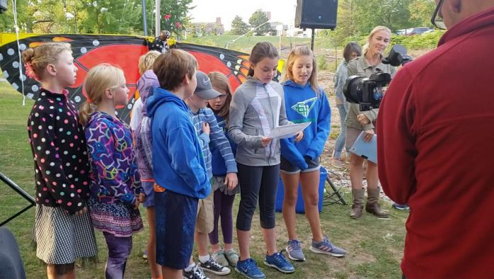 Students from Edmison Heights Public School in Peterborough released a monarch butterfly and read an ode to the threatened pollinator.  (Photo: Jeannine Taylor / kawarthaNOW.com)