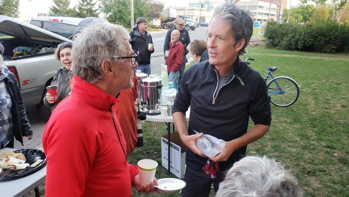 Chef Guenther Schubert, who will ensure everyone stays well-fed during their seven-week journey from Peterborough to Mexico, speaks with Tim Haines, one of the two inaugural runners. Haines is the husband of Monarch Ultra co-founder Carlotta James and the owner of Bluestreak Records. The second inaugural runner is James' best friend Krystal LeBreton.  (Photo: Jeannine Taylor / kawarthaNOW.com)