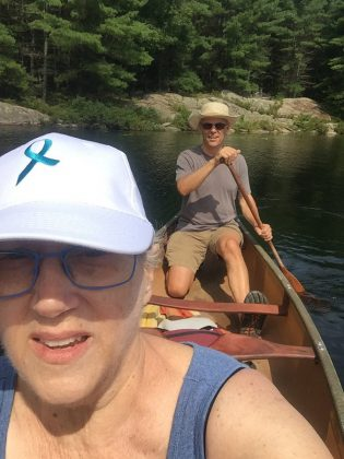 Paul Plant canoeing with his wife Karen Hoffman, who is wearing a Ovarian Cancer Canada Walk of Hope hat. Hoffman, a long-time teacher with the KPR School Board and a volunteer with St. James Players, was diagnosed with ovarian cancer in 2016. She participated in her first Ovarian Cancer Canada Walk of Hope in 2018, and passed away from the cancer in July 2019. Plant is participating in the 2019 Walk of Hope in memory of his late wife.  (Photo: Karen Hoffman)