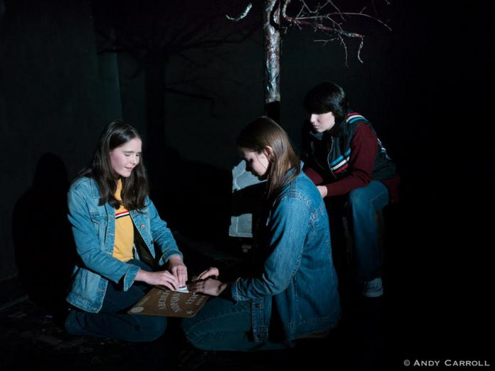 "In Planet 12 Productions' original play ""Tex"", Samuelle Weatherdon, Aimee Gordon, and Emily Keller star as three girls who use an Ouija board on Halloween and contact a spirit who calls himself Tex and leads the girls into a local cemetery in search for the answers to a gruesome murder from their town's past. The show runs from September 25 to 28, 2019 at The Theatre on King in downtown Peterborough. (Photo: Andy Carroll)"