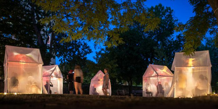 """Trophy"" is a free event where audience members can move between lighted tents to listen to local stories of life-changing moments of transformation. (Photo: Dahlia Katz)"