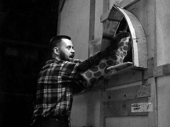 "Rod Coneybeare with Jerome the Giraffe on the set of ""The Friendly Giant"" on May 30, 1965. (Photo: CBC Still Photo Collection)"